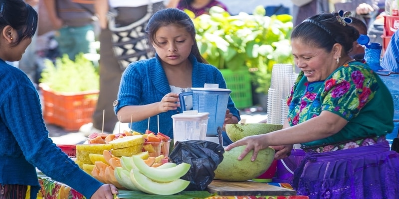 CHICHICASTENANGO , GUATEMALA - JULY 26  Guatemalan woman preparing juice at the Chichicastenango Market on July 26 2015. This native market is the most colorful in Ce